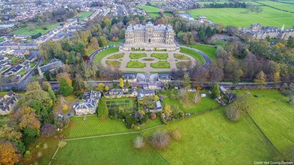 Drone view from above of the local landmark the Bowes Museum, a historic building in French chateau architectural style among gardens, built in the 19th century housing the art and ceramics collection of its founder and his wife, John and Josephine Bowes.