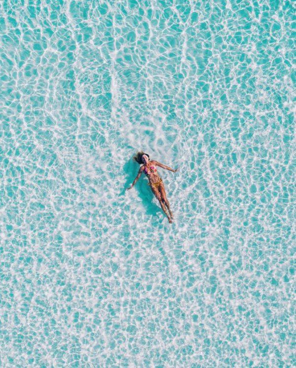 Women laying in the sea