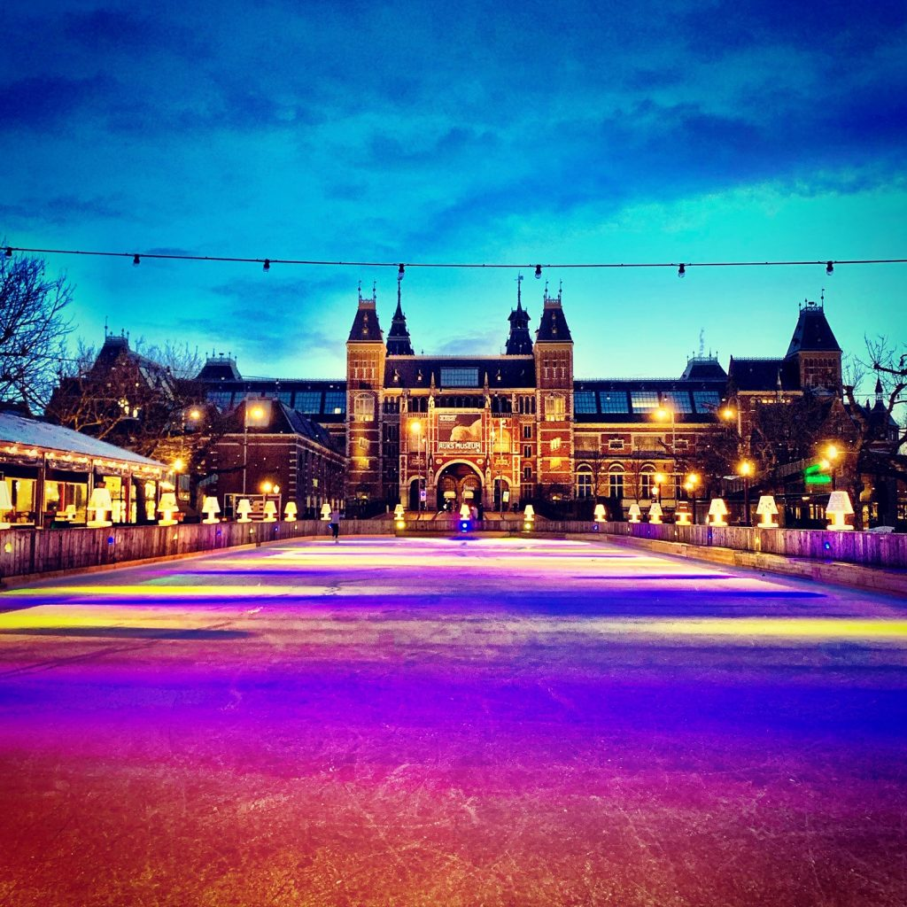 Woman ice-skating at night Amsterdam